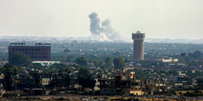 Smoke rises in Egypt's North Sinai as seen from the border of southern Gaza Strip with Egypt on July 1, 2015. ISIS jihadists launched a wide-scale coordinated assault on several military checkpoints in Egypt's North Sinai on Wednesday in which 70 people were killed, security sources said, the largest attack yet in the insurgency-hit province. (Photo: Abed Rahim Khatib /Flash90)